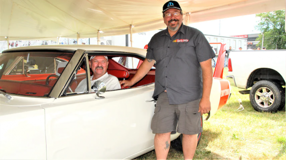 Two men with a 1969 Dodge Daytona