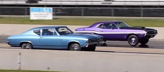 A 1970 Dodge Challenger R/T and a 1969 Chevrolet Chevelle drag racing