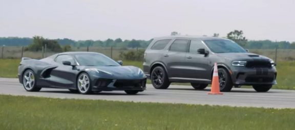 A Dodge Durango SRT Hellcat and a C8 Chevy Corvette drag racing