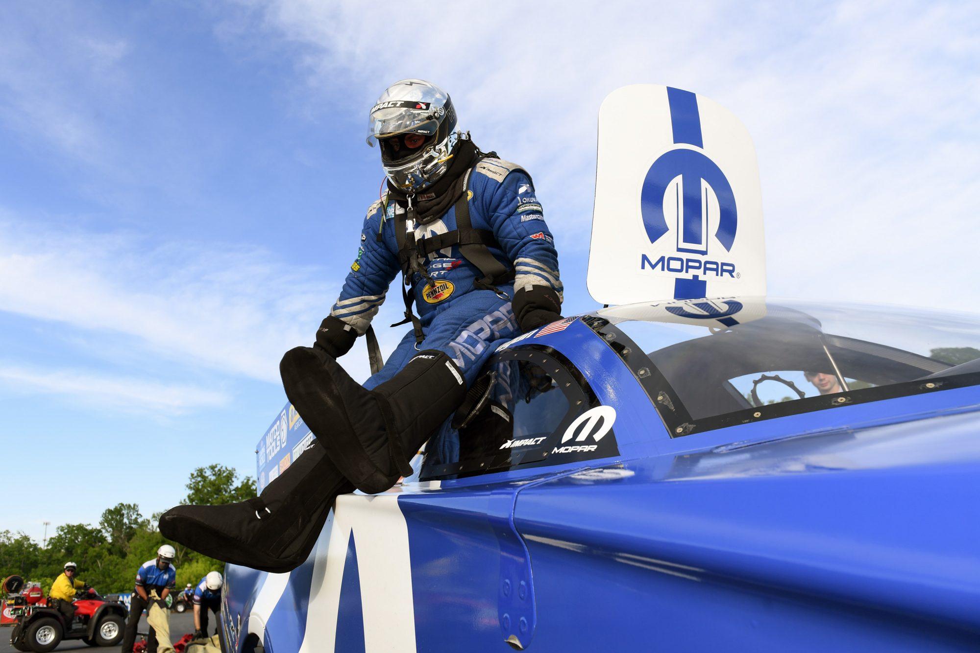 Matt Hagan sitting on top of his funny car