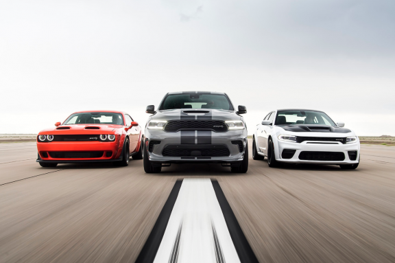 Dodge Challenger, Dodge Durango and Dodge Charger driving side by sider