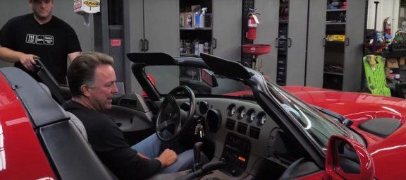 Man sitting in a Dodge Viper