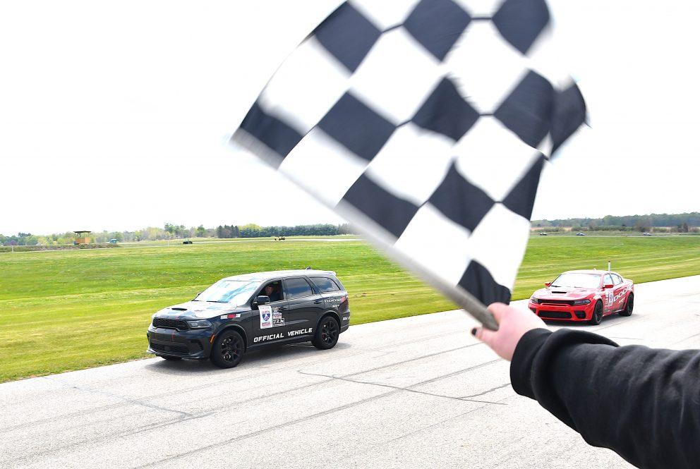 Checkered flag waving at a vehicle