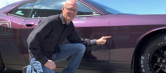 Man with his 2021 Dodge Challenger Mopar Drag Pak