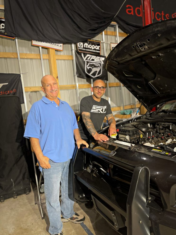 Matt and his dad working on a truck