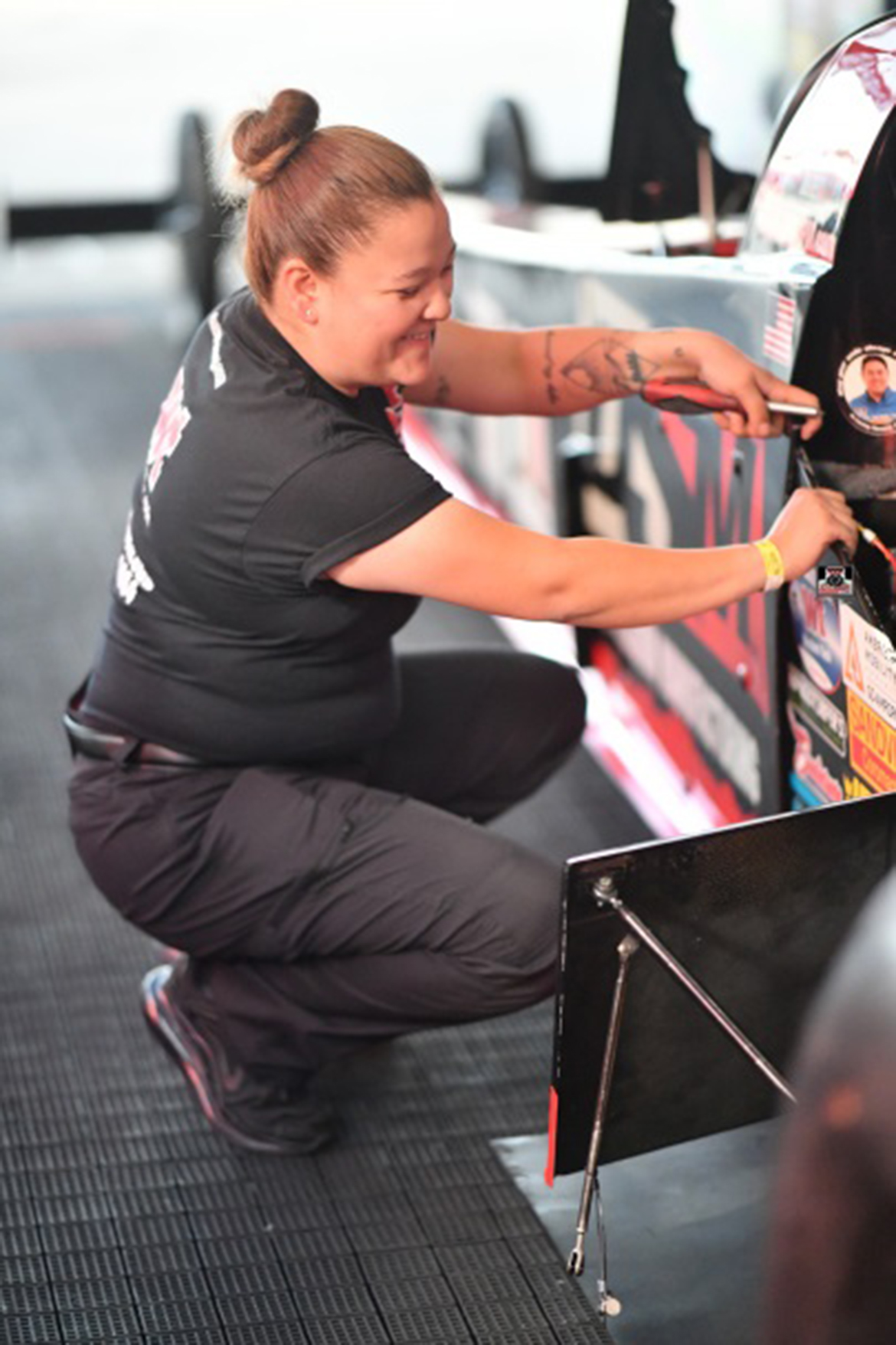 Eileen Dominguez working on a vehicle