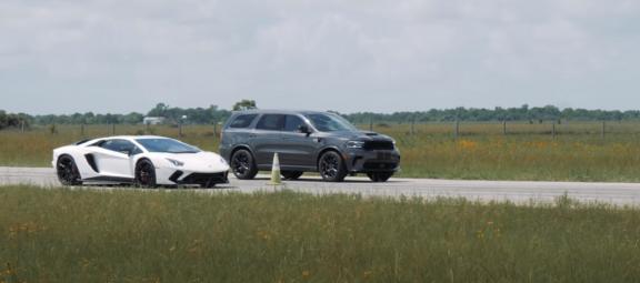 Dodge Durango and Lamborghini Aventador lined up for a drag race