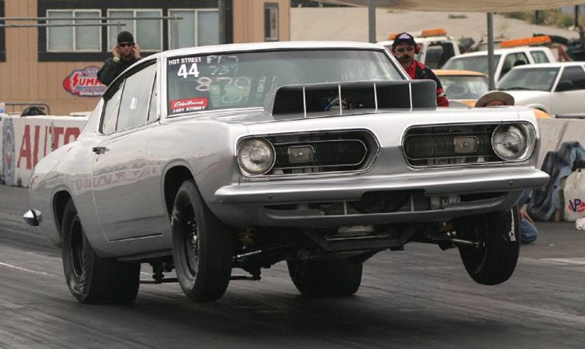 Vehicle on two wheels on a drag strip