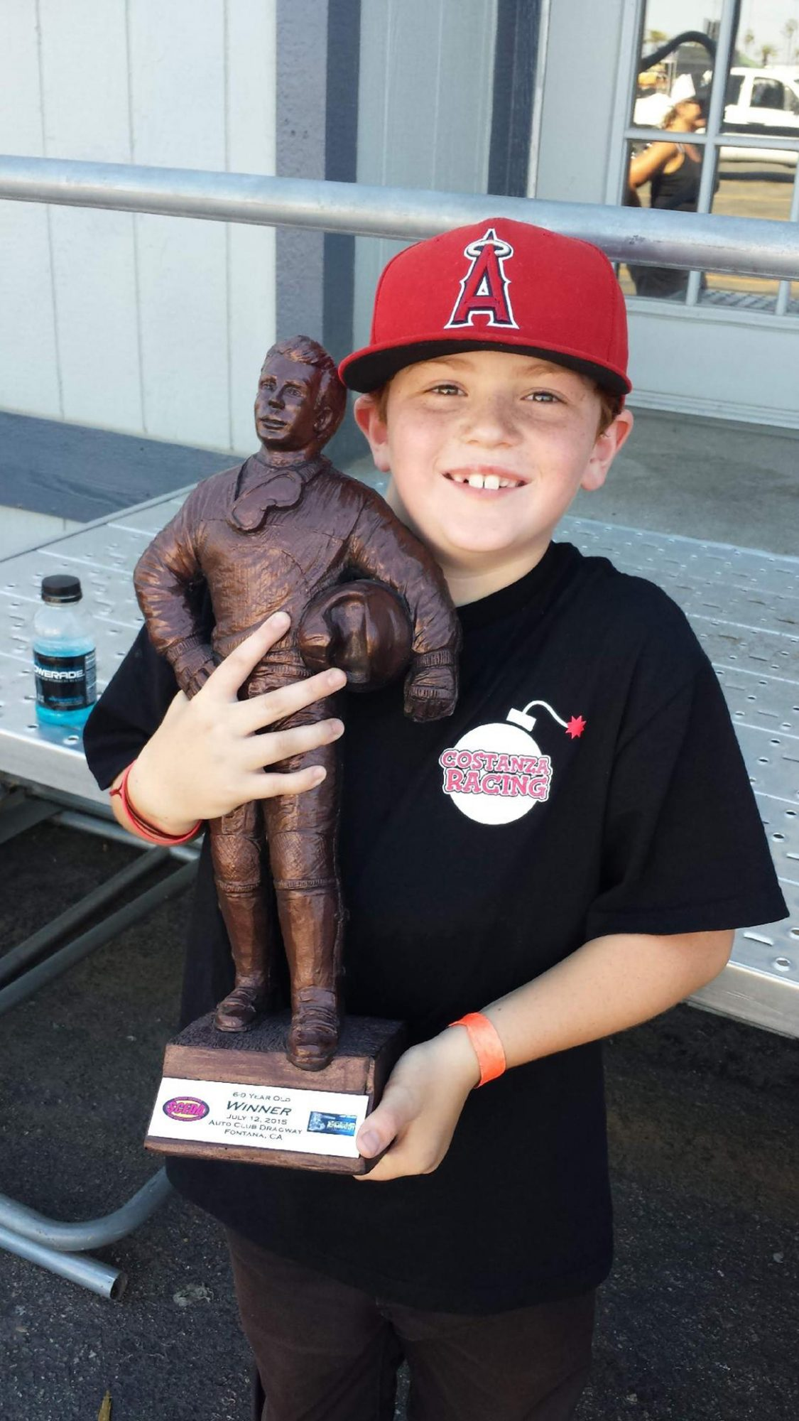 Young boy holding a trophy