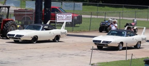 Two Plymouth Superbirds on the starting line of a drag strip