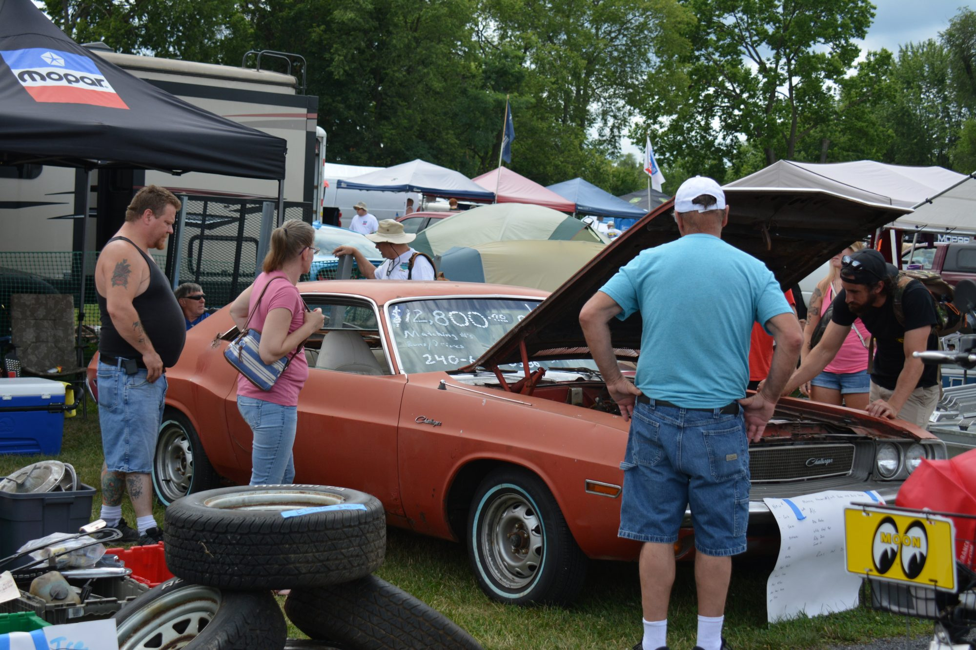 Spectators looking at a vehicle on display
