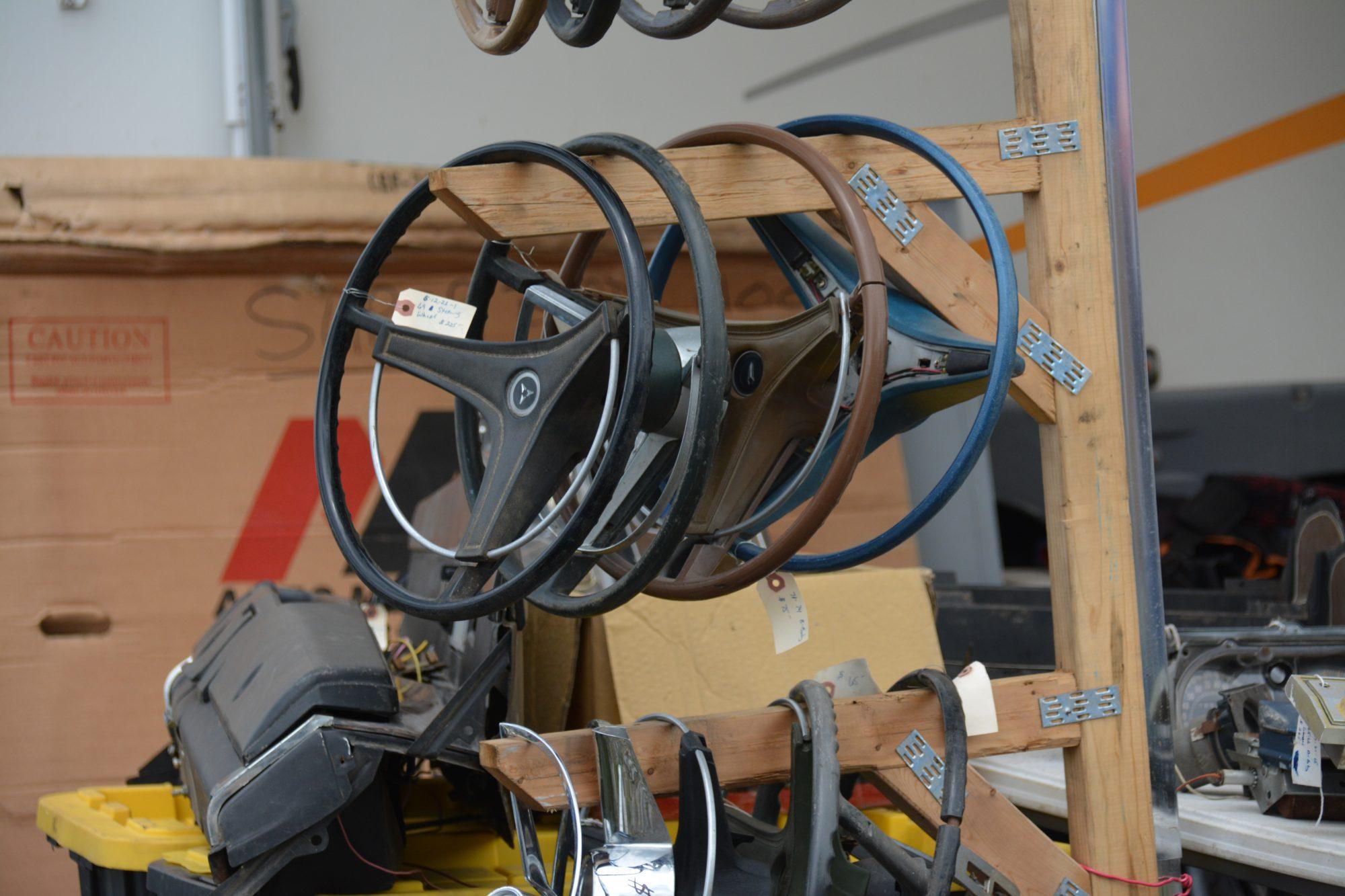 Steering wheels hanging on a rack