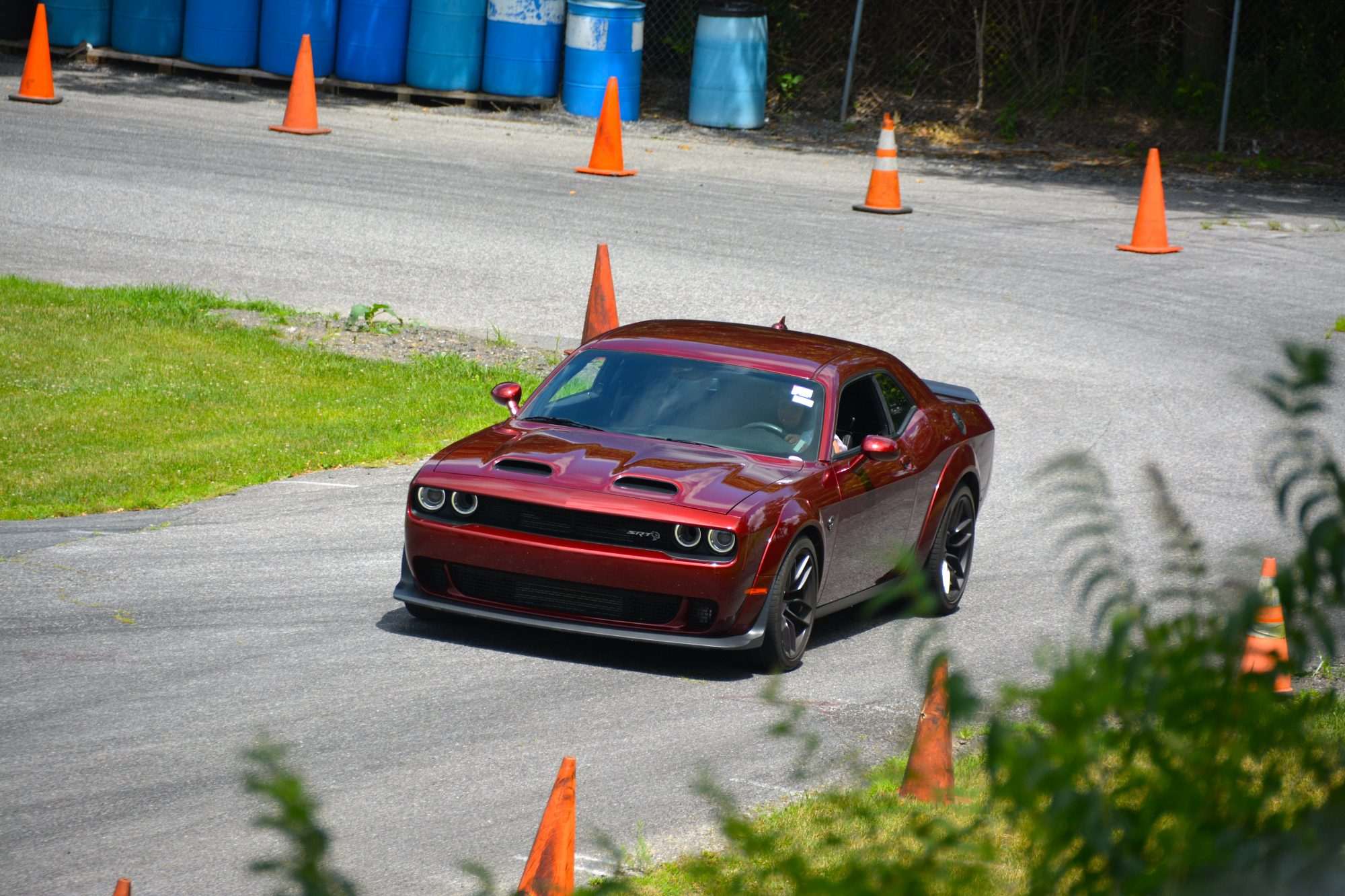 Dodge Challenger driving down a road course