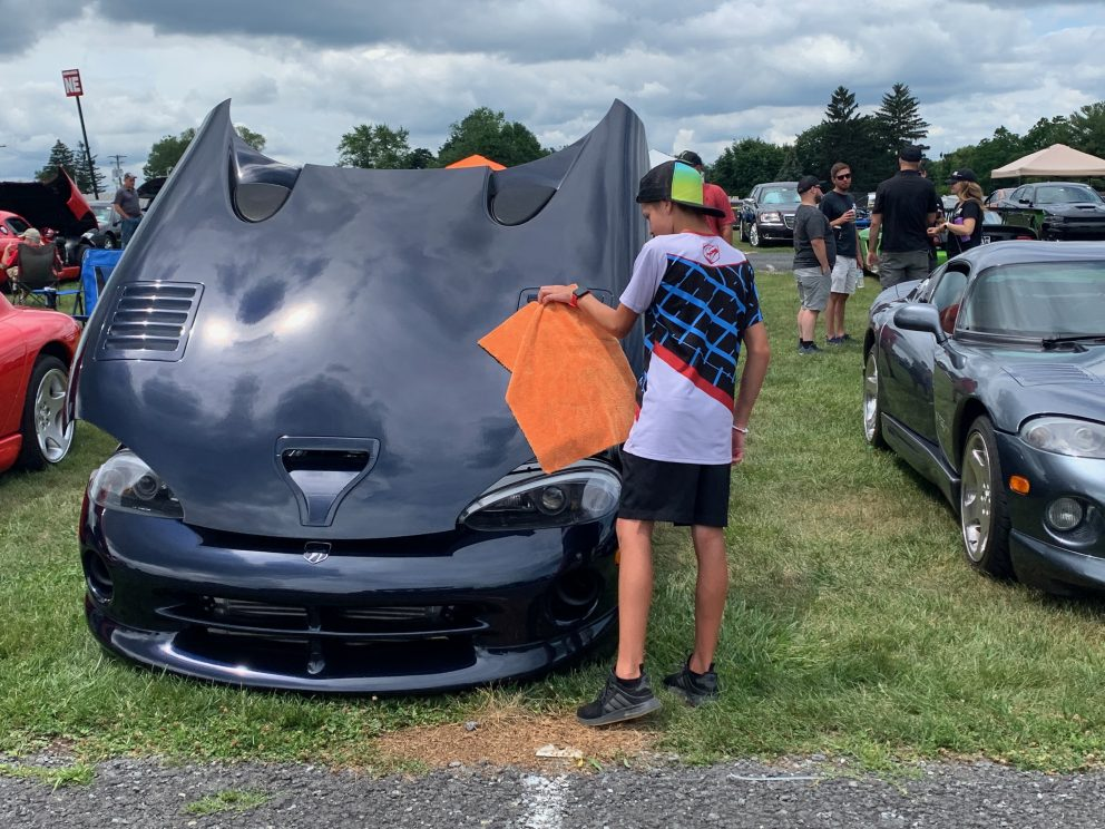 Owners wiping off their vehicle on display