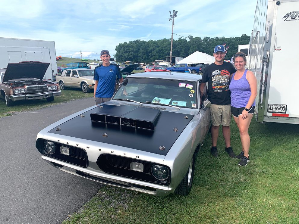 Owners with their vehicle on display