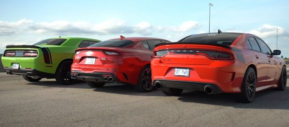Kia Stinger GT AWD, Dodge Charger Scat Pack Daytona and a Dodge Challenger Scat Pack parked next to one another