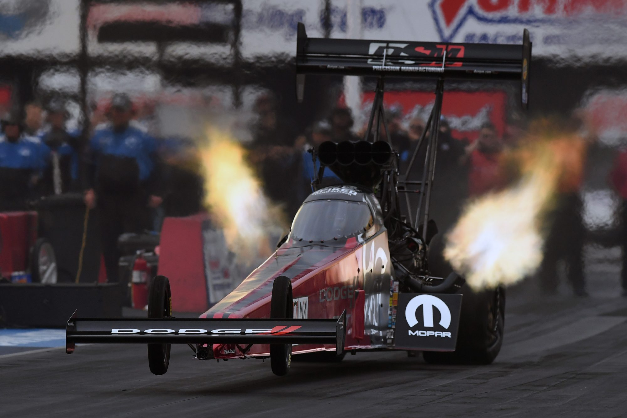 Precision Manufacturing Dragster with fire coming out of it