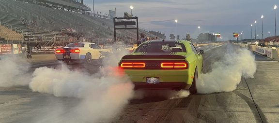 Two challengers doing burnouts prior to drag racing