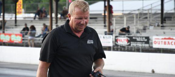 Kurt Johnson walking on a race track