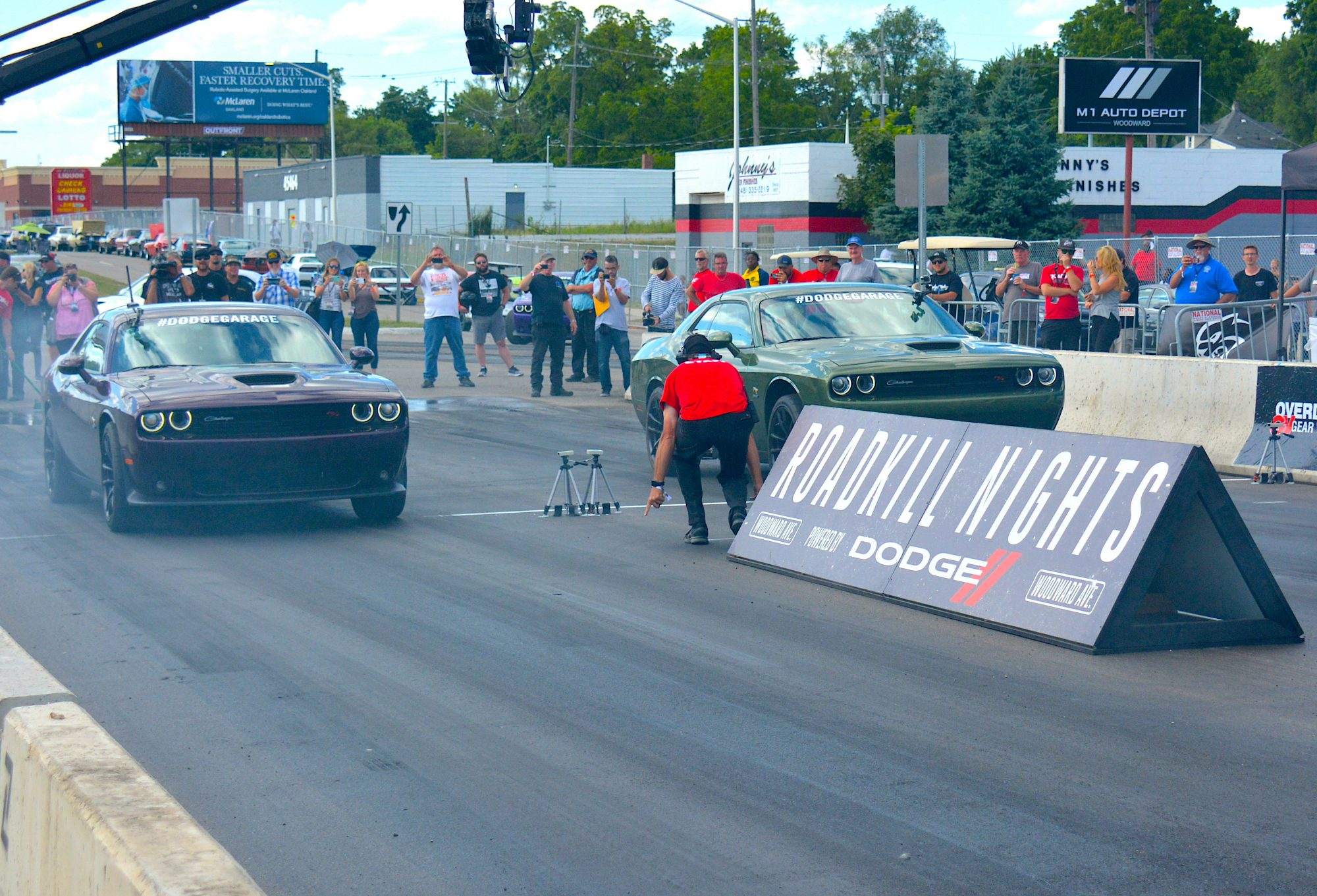 Two Challengers drag racing