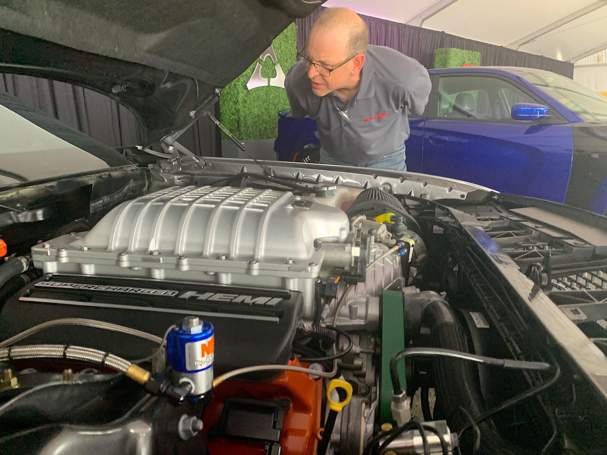 Man looking at a HEMI engine