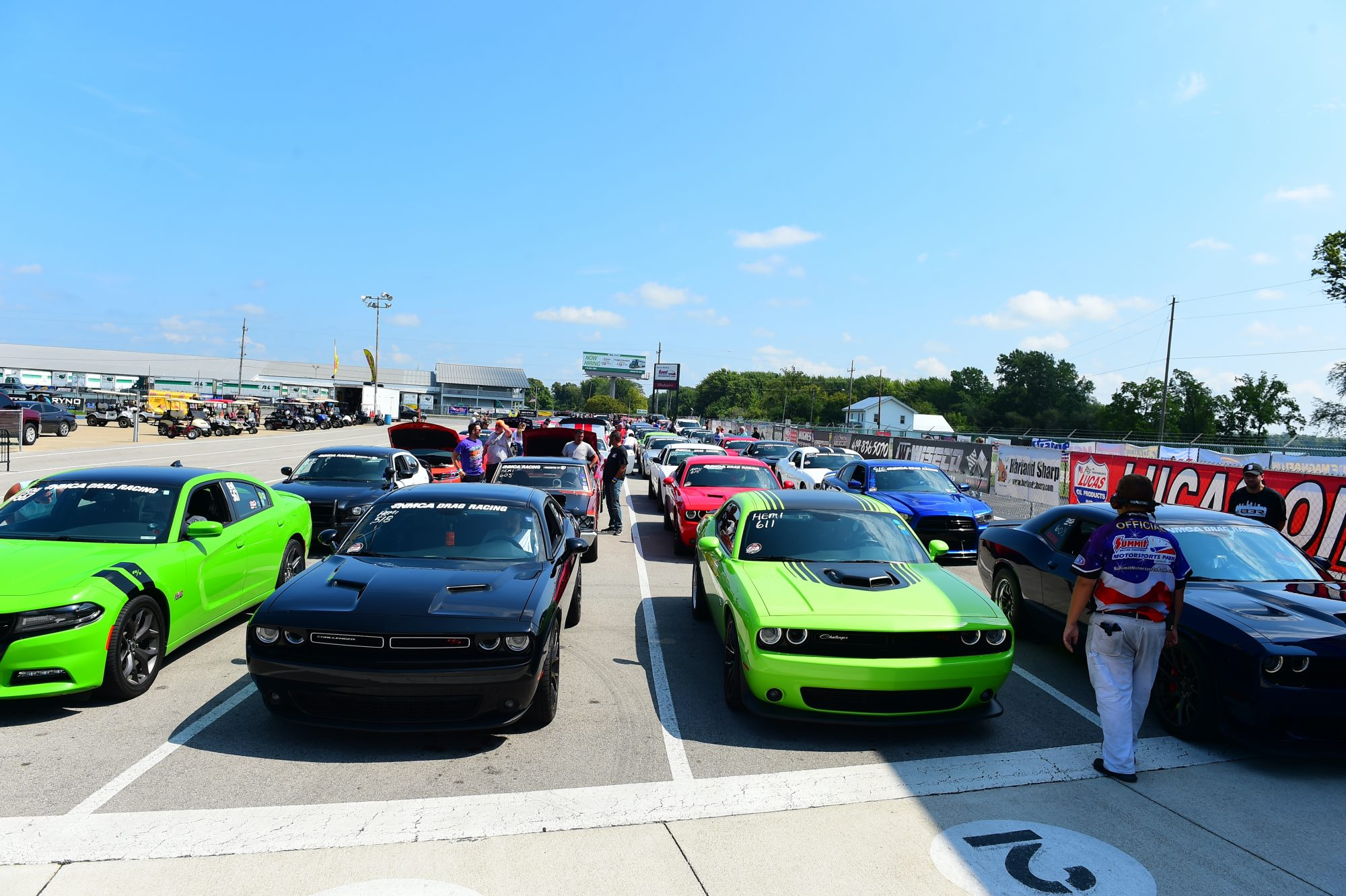 Row of cars getting ready to drag race