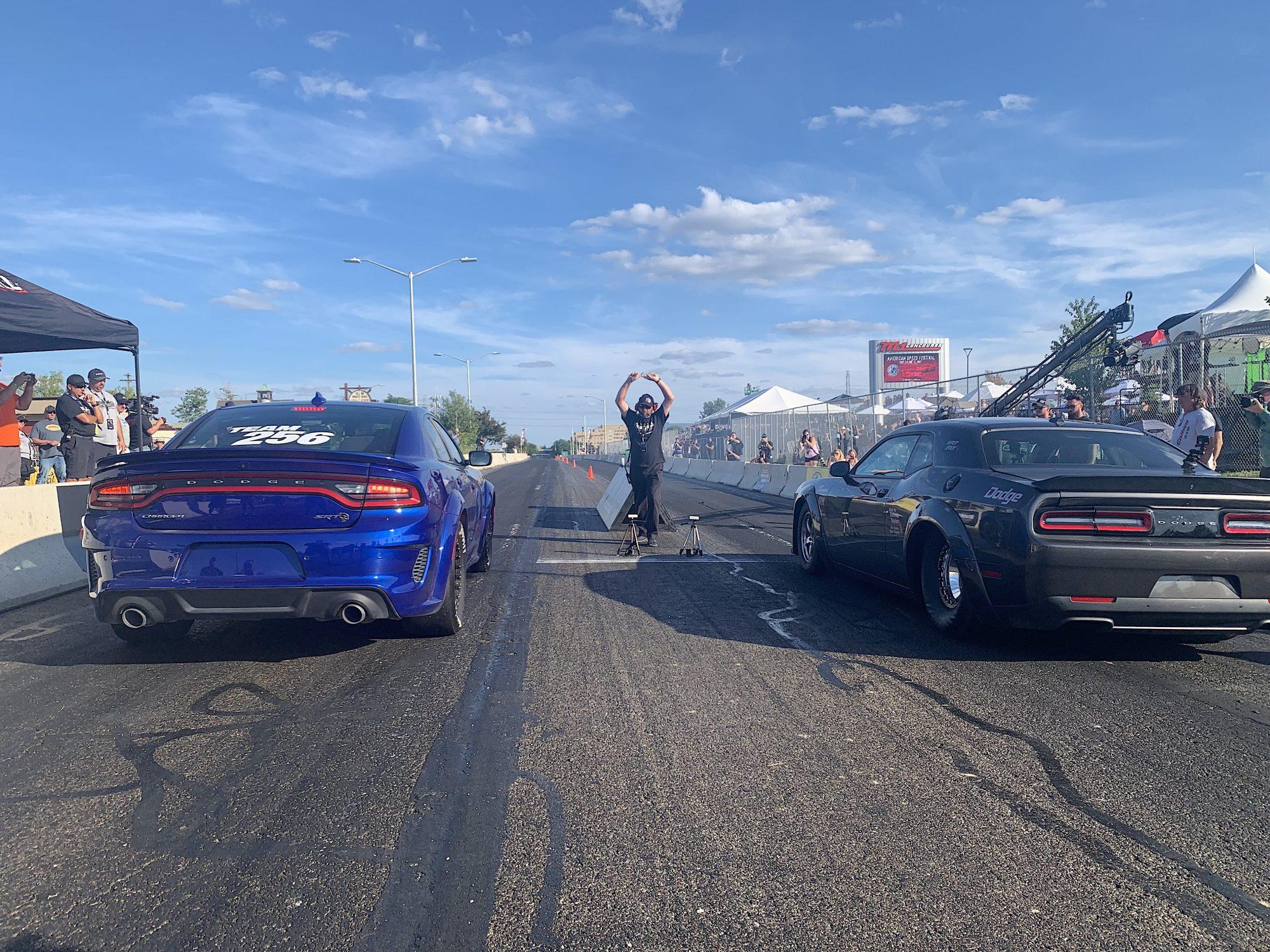 Two cars drag racing