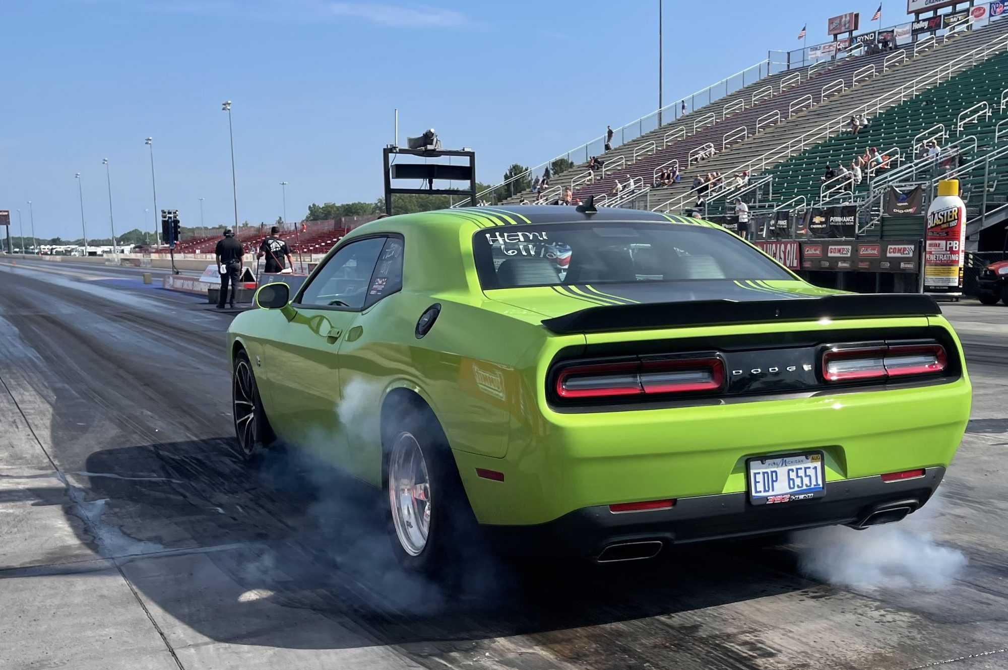 Challenger doing a burnout before drag racing