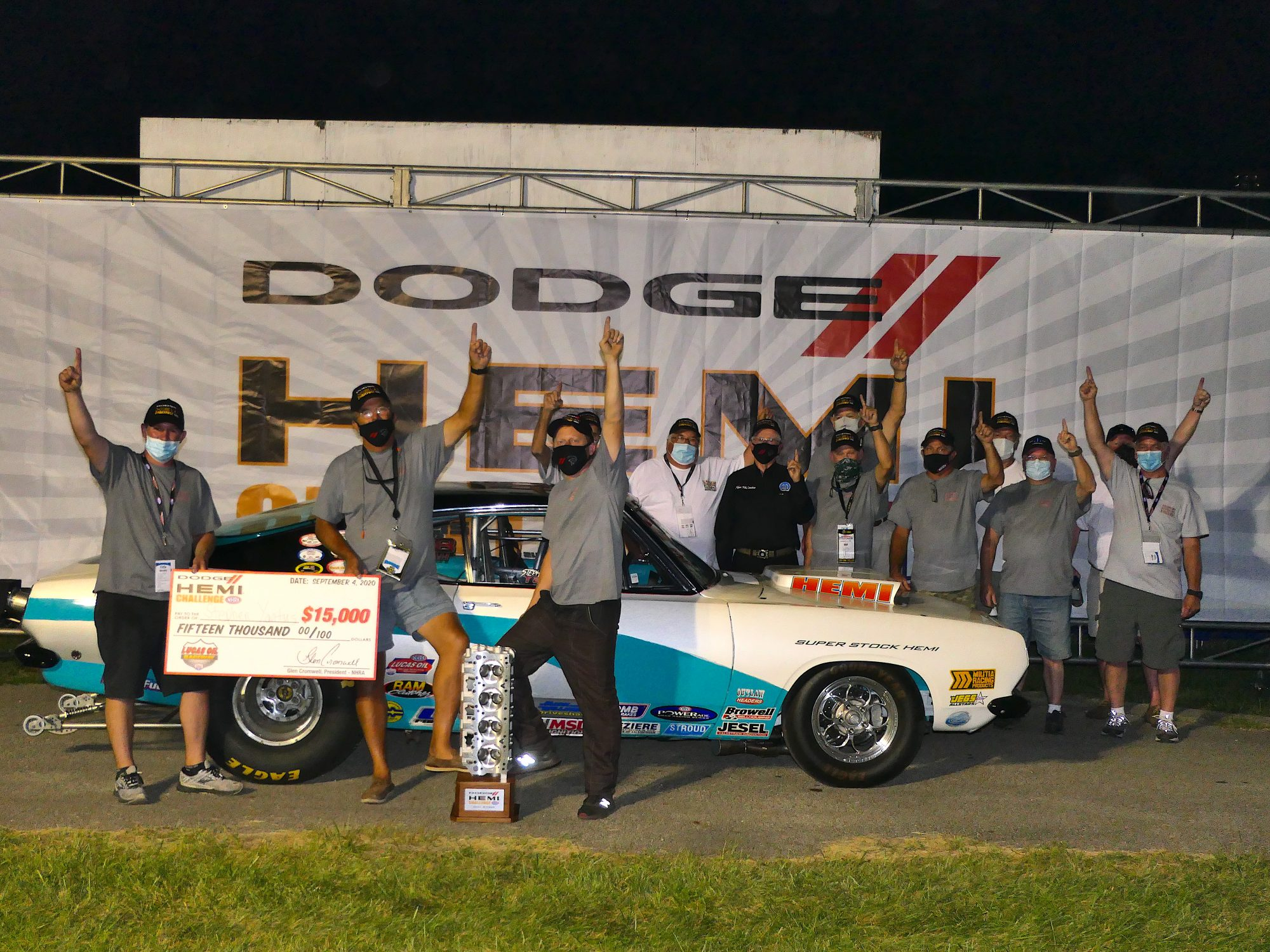 Drag racers celebrating a win