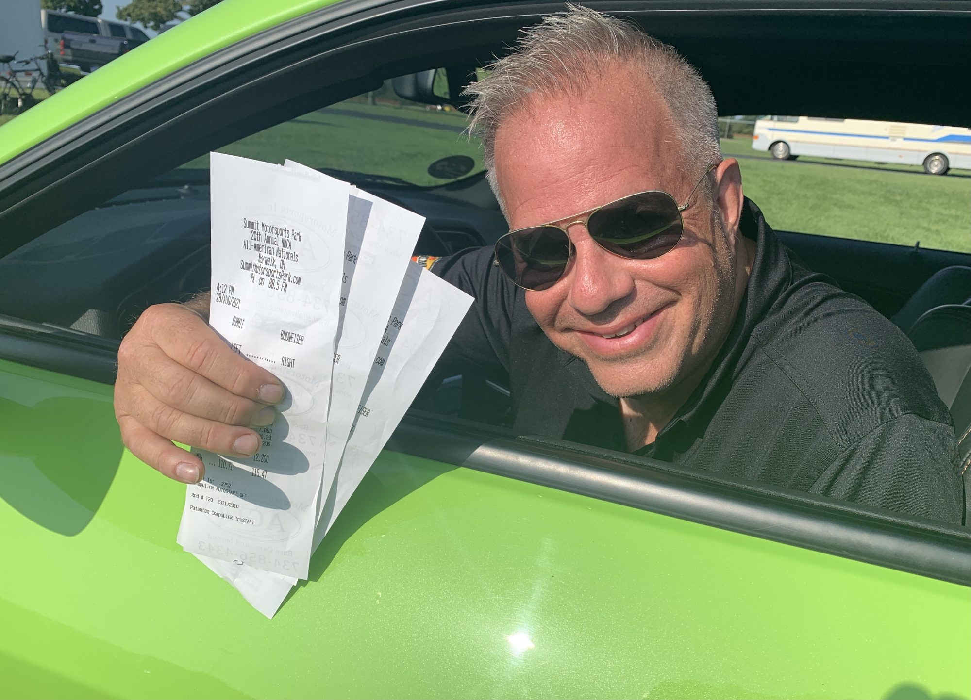 Man showing off his time slips