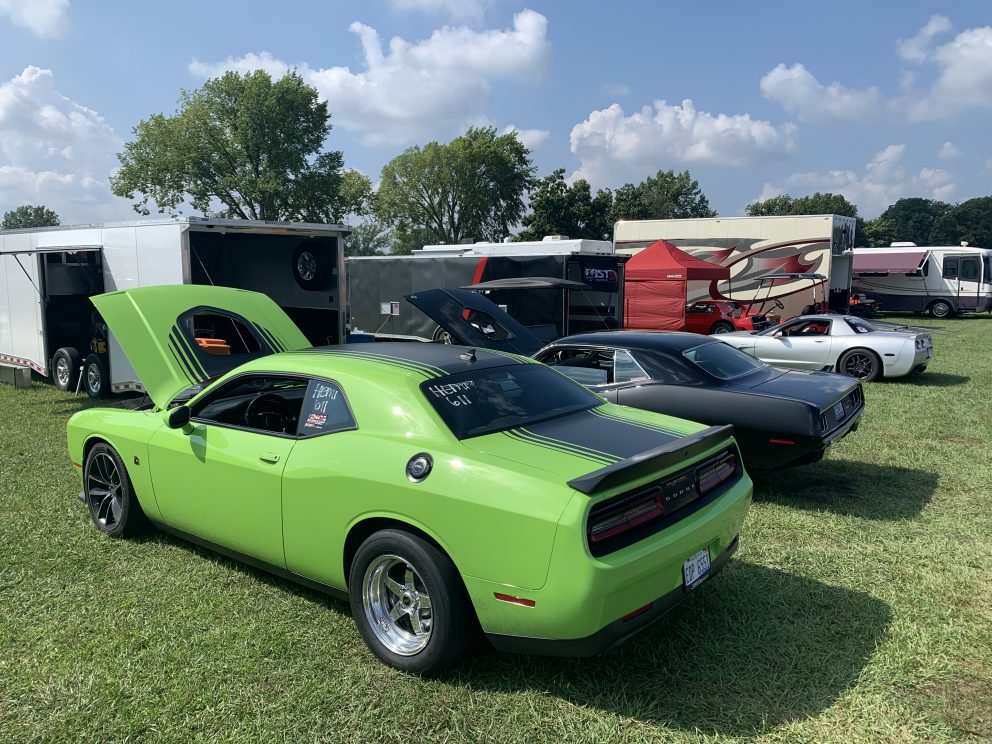 Challenger and other cars in the pit area of a drag race