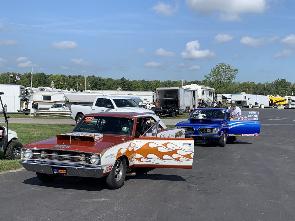 vintage cars getting ready to drag race