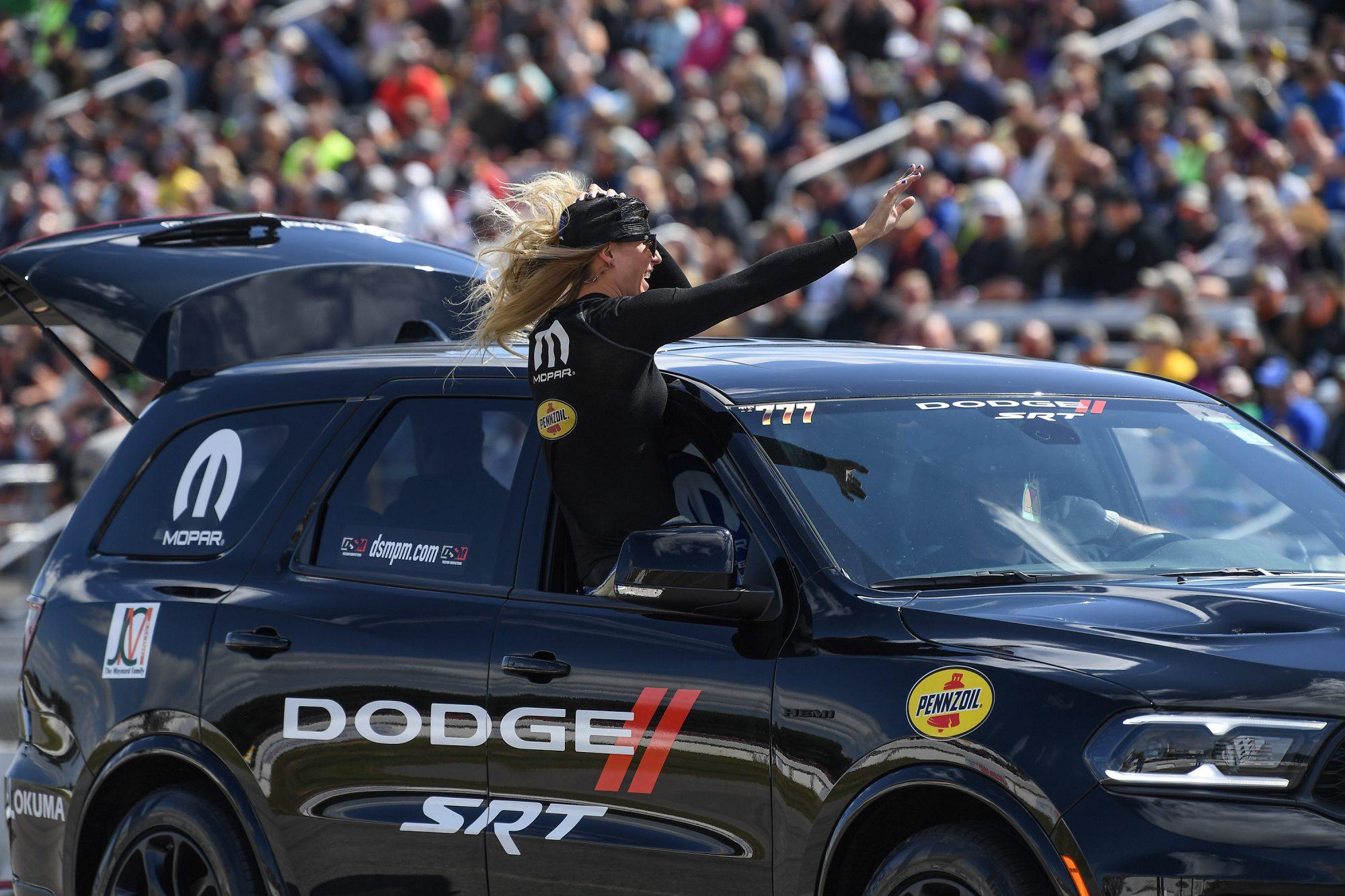 Leah Pruett waving to fans