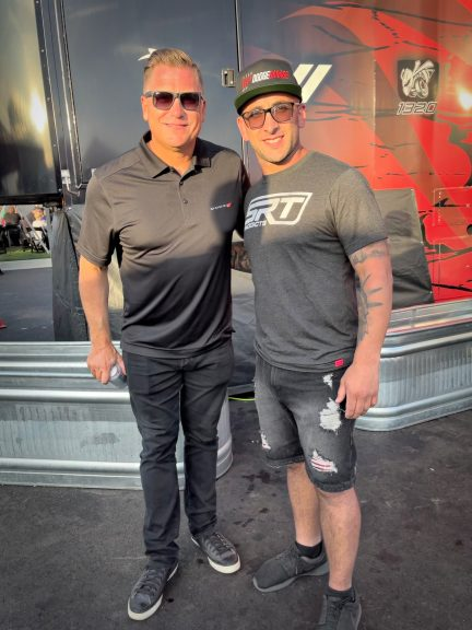 Matt Greenstein posing with Tim Kuniskis at Roadkill Nights Powered by Dodge
