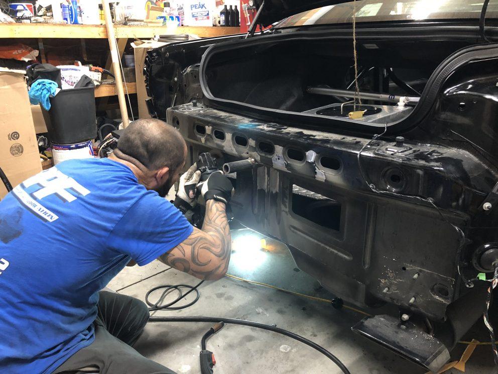 Man working on a Dodge Challenger