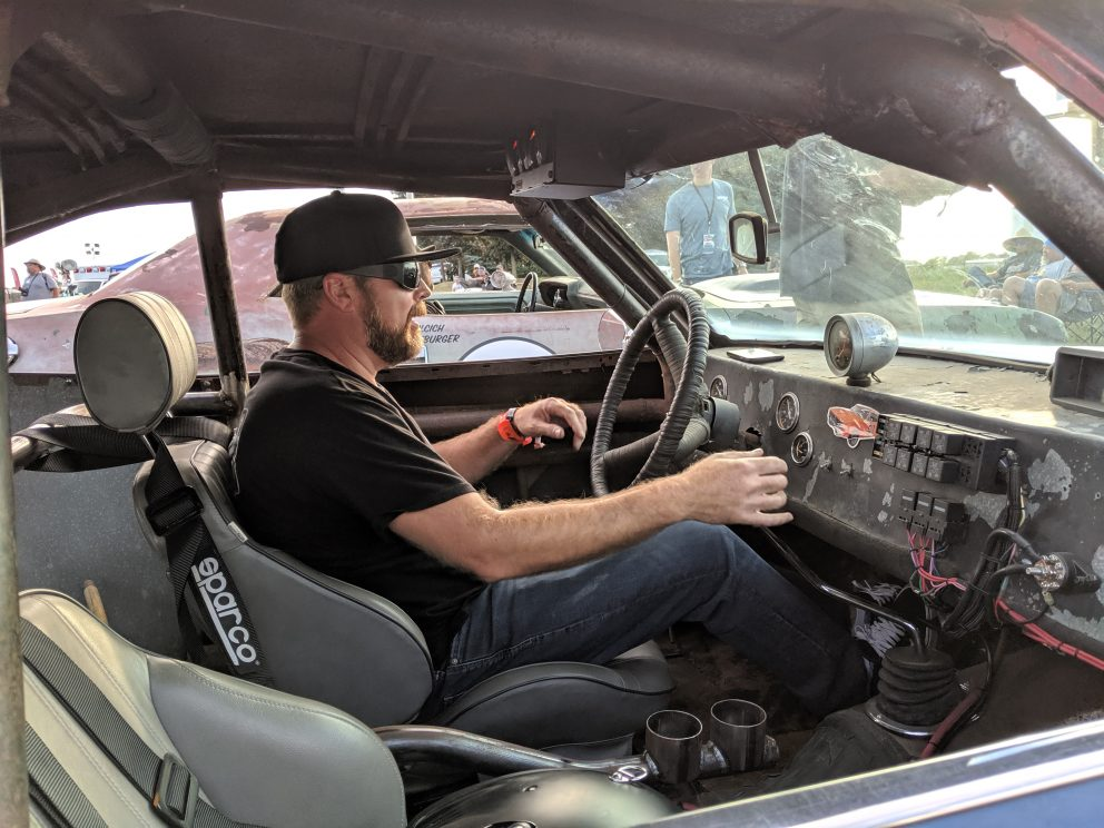 Man in the driver's seat of a vehicle