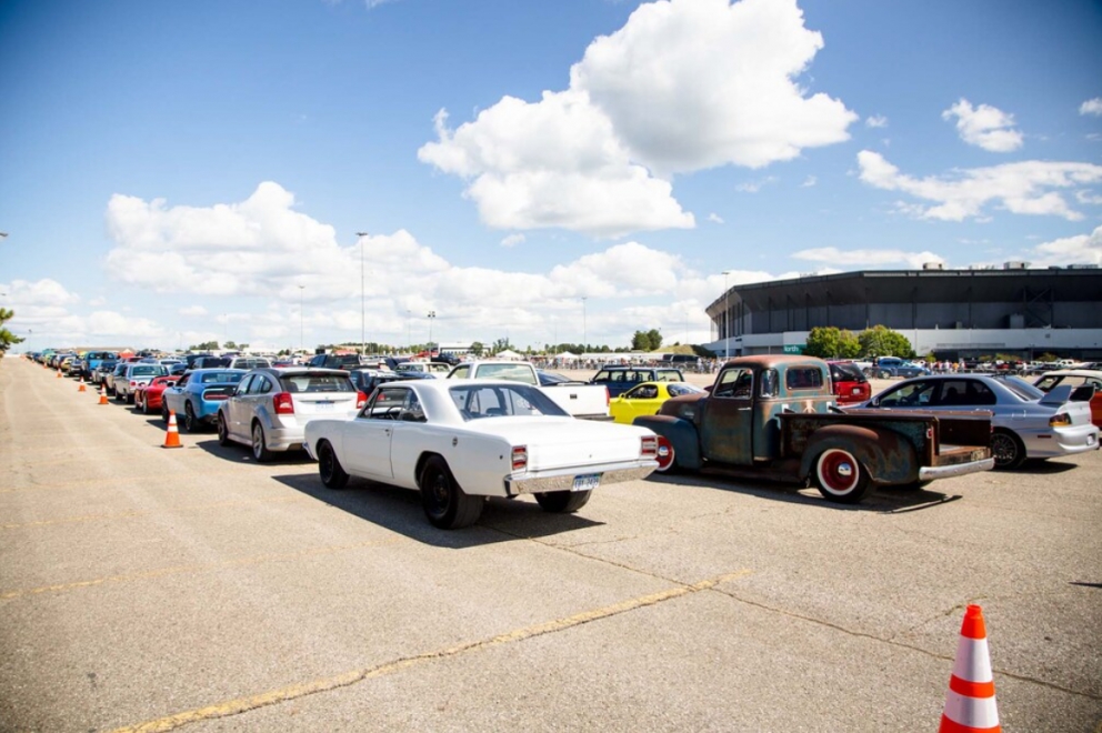 row of cars ready to drag race at Roadkill Nights Powered by Dodge