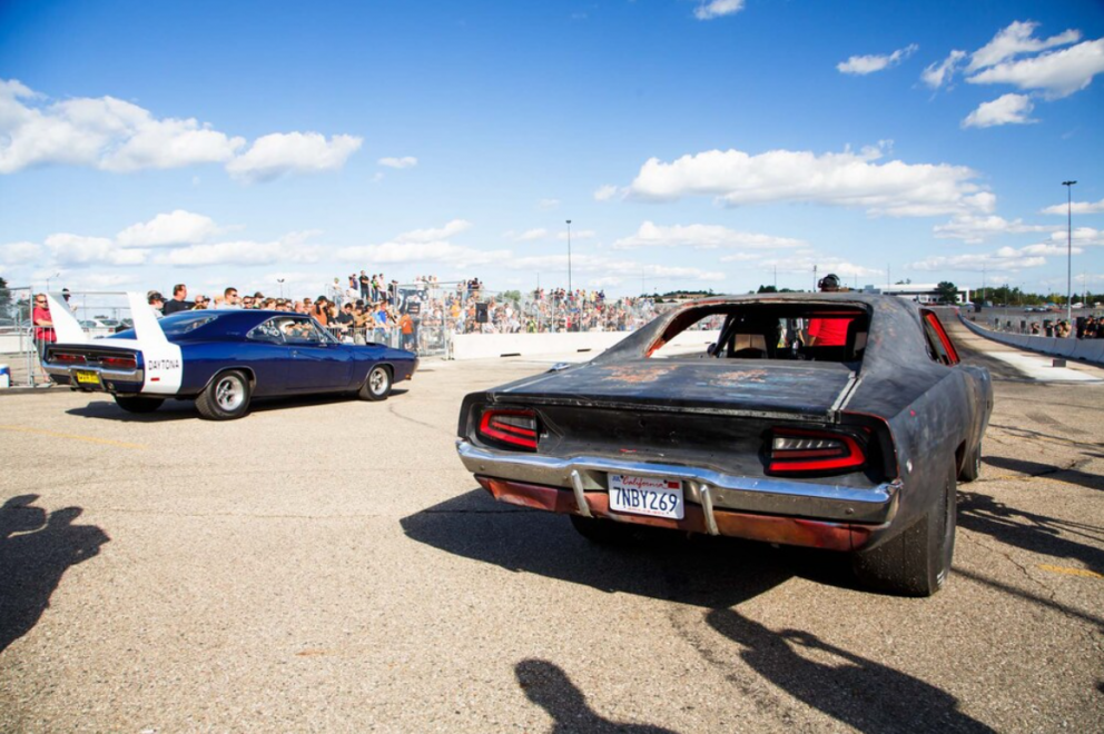 two cars getting ready to drag race at Roadkill Nights Powered by Dodge