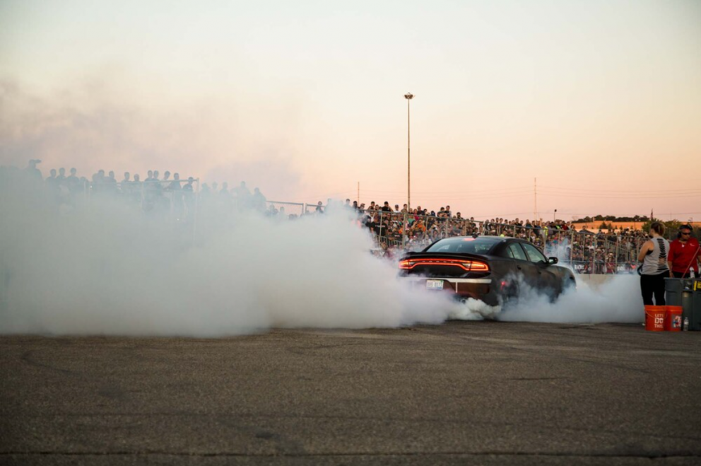Charger doing a burnout at Roadkill Nights Powered by Dodge