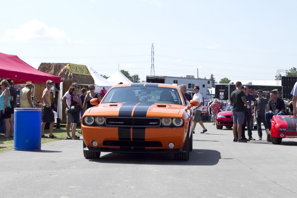 Challenger driving through Roadkill Nights Powered by Dodge