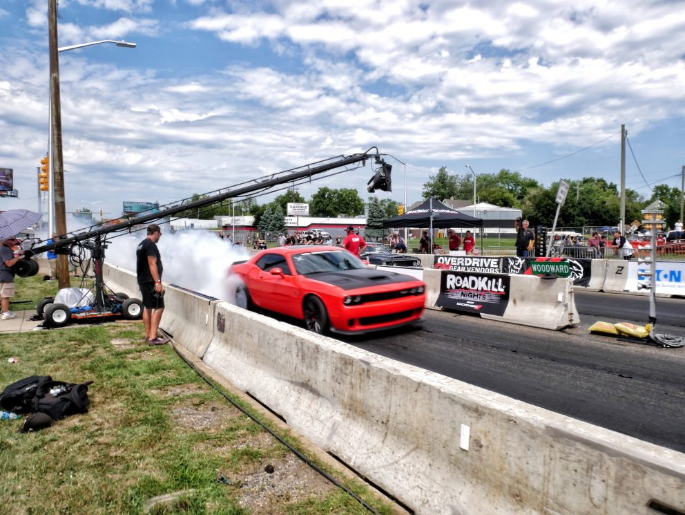 Challenger drag racing on Woodward during Roadkill Nights Powered by Dodge