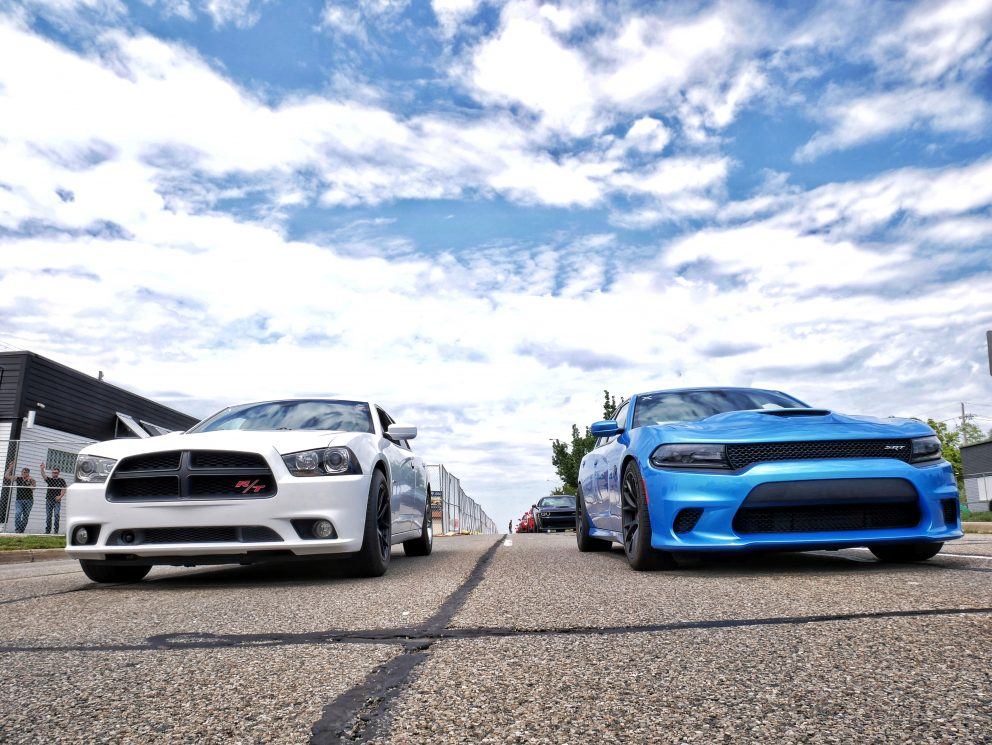 2 Chargers lined up to drag race at Roadkill Nights Powered by Dodge