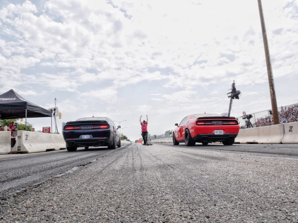 Two cars lining up to race at Roadkill Nights Powered by Dodge