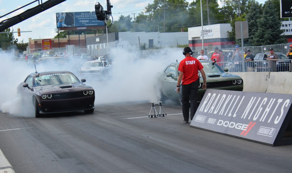 Two cars doing burnouts prior to racing at Roadkill Nights Powered by Dodge