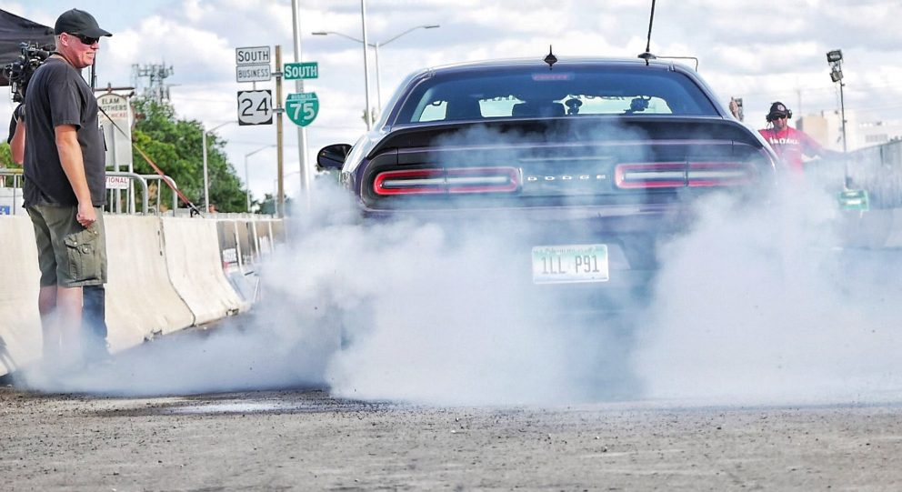 Challenger doing a burnout at Roadkill Nights Powered by Dodge