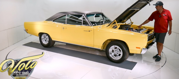 Man with a. 1969 Plymouth Road Runner Restomod