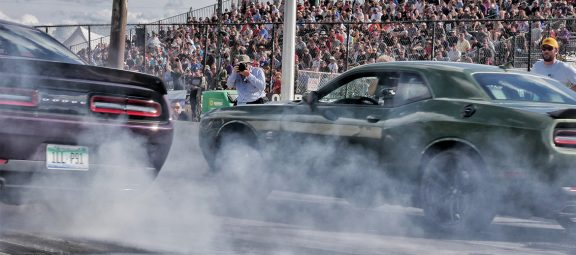 Vehicles on the starting line of a drag strip
