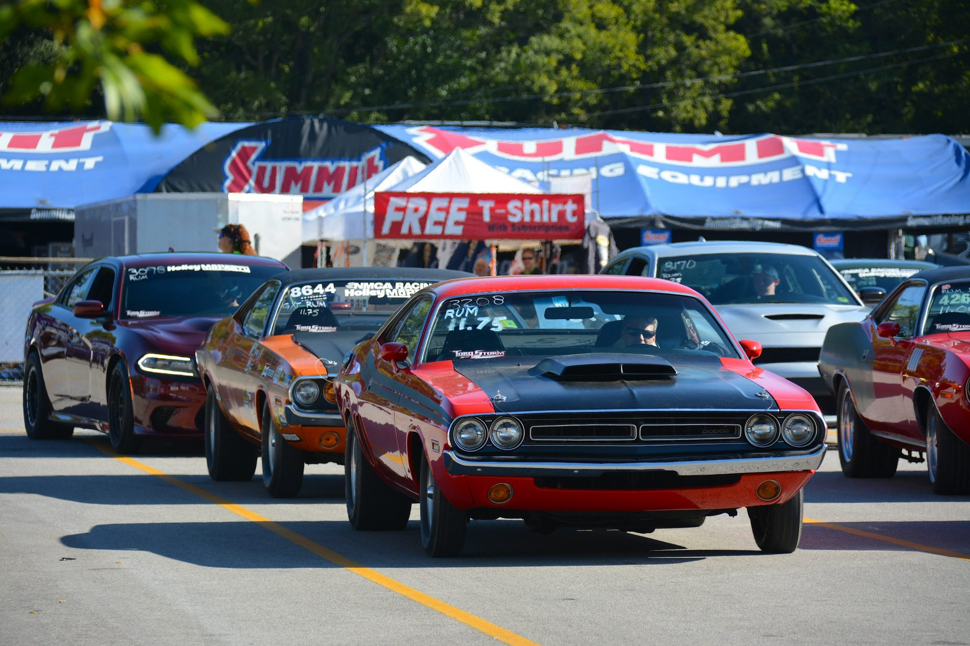 Row of Dodge vehicles getting ready to drag race