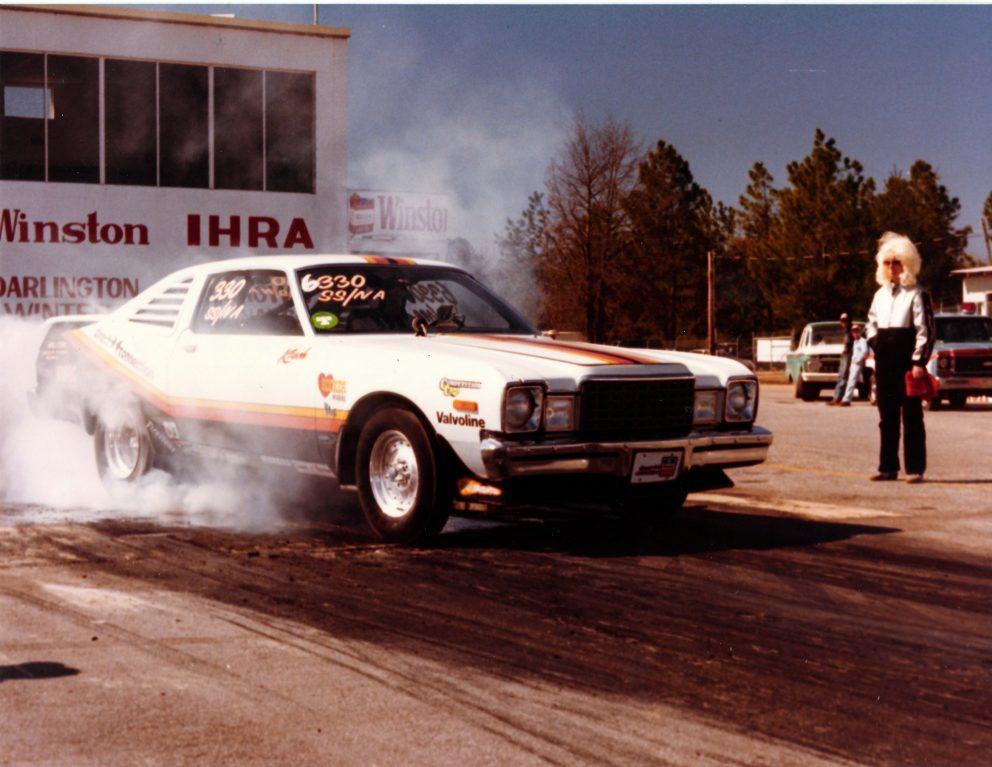 Vintage race car doing a burnout