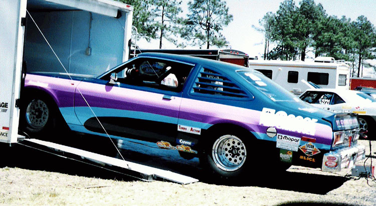 Drag car coming off a trailer